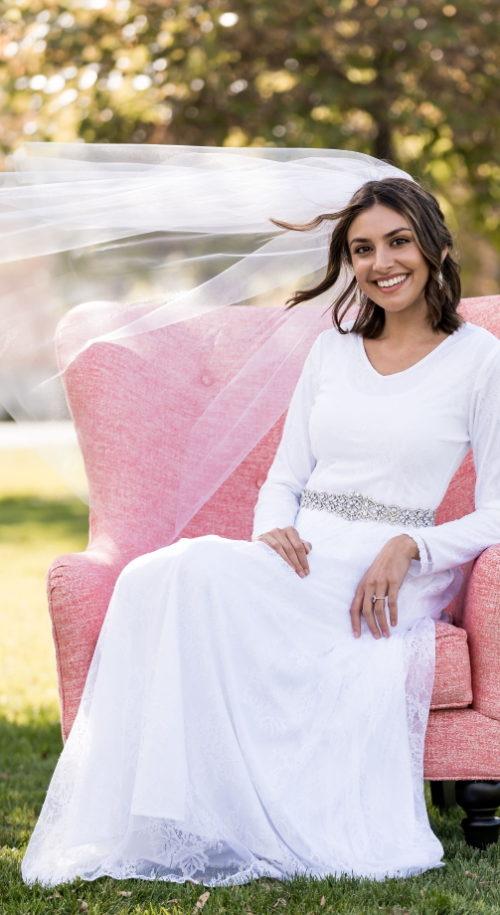 Springville Wedding Dress - Smiling Bride on Chair - Affordable Lace Wedding Dress