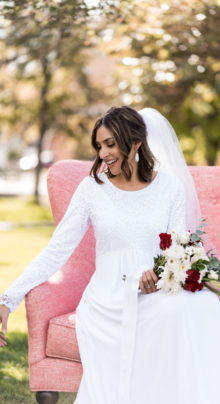London White Wedding Dress - Bride in Chair Close-up - Modest & Affordable