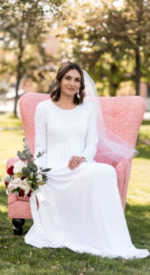 London White Wedding Dress - Bride in Chair - Modest & Affordable